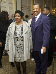 Aretha Franklin and boyfriend William Wilkerson arrive to her seventieth birthday party in New York, Saturday, March 24, 2012. (AP Photo/Charles Sykes)