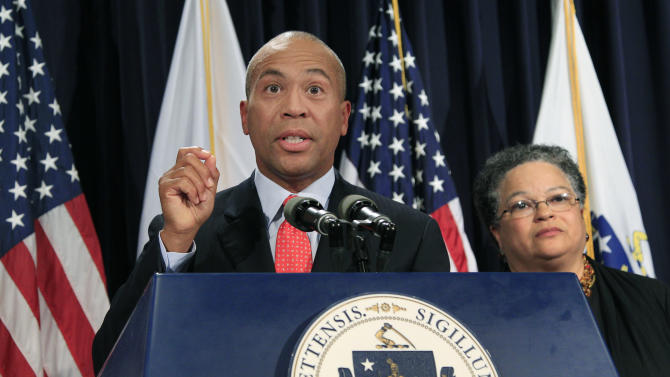FILE - In this June 28, 2012, file photo, Massachusetts Gov. Deval Patrick speaks, as Health and Human Services Secretary JudyAnn Bigby listens at right, during a news conference at the Statehouse in Boston, where he spoke about the U.S. Supreme Court's decision to uphold President Barack Obama's health care overhaul. Some of President Barack Obama's former advisers are proposing major changes aimed at controlling health care costs as political uncertainty hovers over his health law. Call it Health Care Overhaul, Version 2.0. Their biggest idea is a first-ever budget for the nation's $2.8-trillion health care system, through negotiated limits on public and private spending in each state. The approach broadly resembles a Massachusetts law signed this summer by Patrick that puts pressure on hospitals, insurers, and other major players to keep rising costs within manageable limits. It could become the Democratic counterpoint to private market strategies favored by Republican presidential nominee Mitt Romney and running mate Paul Ryan. (AP Photo/Elise Amendola, File)