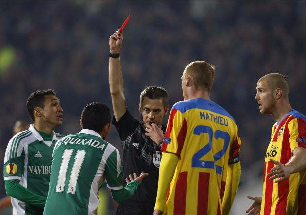 Quixada of Ludogorets reacts as he receives a red card by referee Turpin of France during their Europa League match against Valencia in Sofia