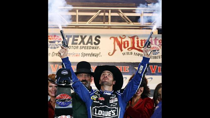 FILE - In this Nov. 4, 2012, file photo, Jimmie Johnson fires blanks out of a pair of revolvers as he celebrates his win in Victory Lane following the NASCAR Sprint Cup Series auto race at Texas Motor Speedway, in Fort Worth, Texas. The National Rifle Association is taking its relationship with racing to a new level as the title sponsor of a NASCAR Sprint Cup Series race. The deal with Texas Motor Speedway comes at a time when the NRA is involved in a renewed debate on gun violence in the wake of the December shooting at Sandy Hook Elementary School in Newtown, Conn. (AP Photo/Tim Sharp, File)