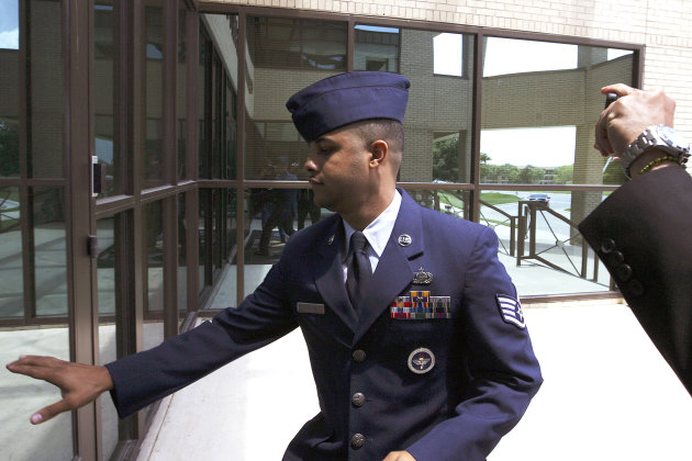 U.S. Air Force Staff Sgt. Luis A. Walker arrives from a lunch break during his court martial at Lackland Air Force Base, Monday, July 16, 2012 in San Antonio. Walker, a former training officer, is charged with illicit sexual contact with 10 female trainees. He is facing 28 counts including rape and is one of 12 instructors under investigation. (AP Photo/The San Antonio Express-News, Jerry Lara)