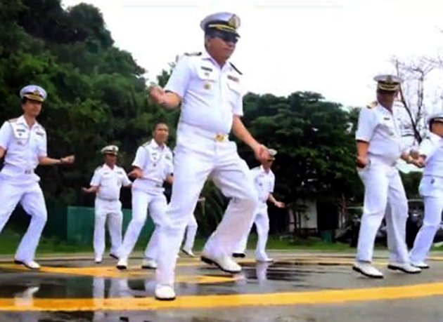 In this image made from an undated video released by Thai Royal Navy, Thai sailors perform the rodeo-style dance and other hip-shaking moves at their base on the popular tourist island of Phuket, southern Thailand. The &quot;Gangnam Style&quot; craze has reached Thailand&#39;s navy, which is among the latest to mimic the globally popular dance video by South Korean singer PSY. (AP Photo/Royal Thai Navy) EDITORIAL USE ONLY, NO SALES