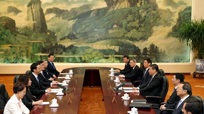 Chairman of Taiwan's ruling Nationalist Kuomintang Party Eric Chu and China's President Xi Jinping meet in Beijing