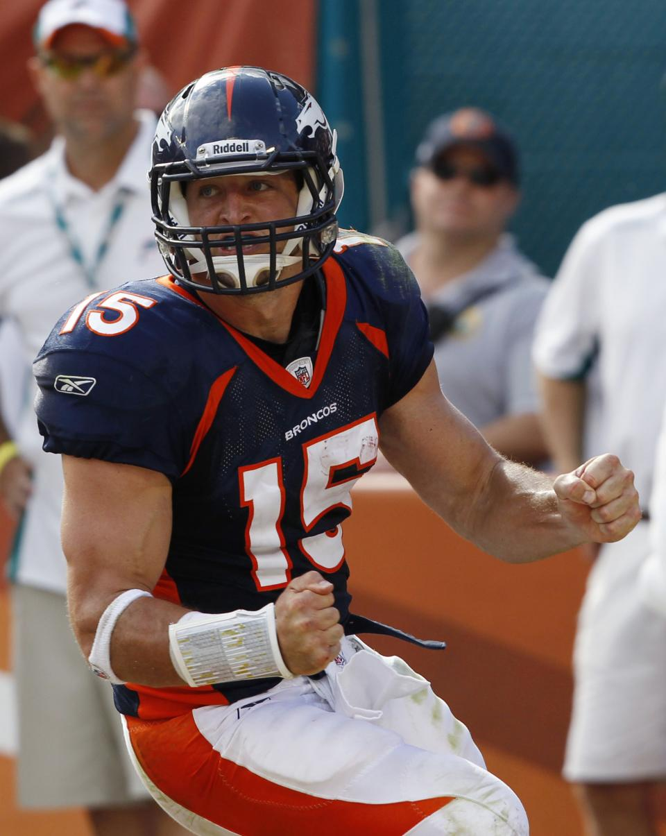 Denver Broncos quarterback Tim Tebow celebrates a 2-point conversion during the second half of an NFL football game against the Miami Dolphins, Sunday, Oct. 23, 2011, in Miami. (AP Photo/Hans Deryk)