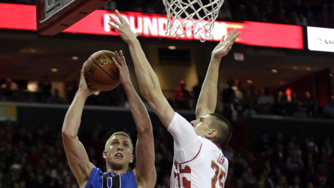 Duke forward Mason Plumlee, left, goes up for a shot against Maryland center Alex Len, of Ukraine, in the first half of an NCAA college basketball game in College Park, Md., Saturday, Feb. 16, 2013. (AP Photo/Patrick Semansky)