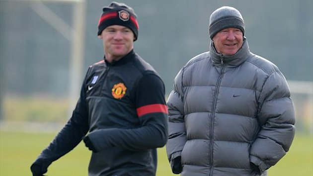 Sir Alex Ferguson and Wayne Rooney at Manchester United training (AFP)