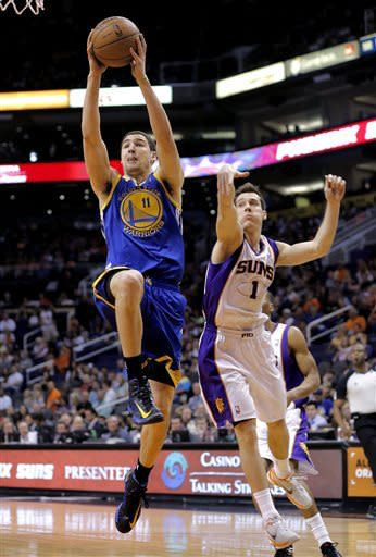 Curry's 18 points, 15 assists lead Warriors to win