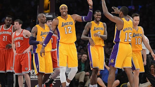 Dwight Howard #12 of the Los Angeles Lakers celebrates his basket and foul with Metta World Peace #15, Kobe Bryant #24 and Earl Clark #6 during a 104-88 win over the Milwaukee Bucks at Staples Center on January 15, 2013 in Los Angeles (AFP)