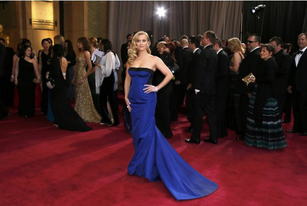Actress Reese Witherspoon, wearing a black and royal blue Louis Vuitton gown, arrives at the 85th Academy Awards in Hollywood