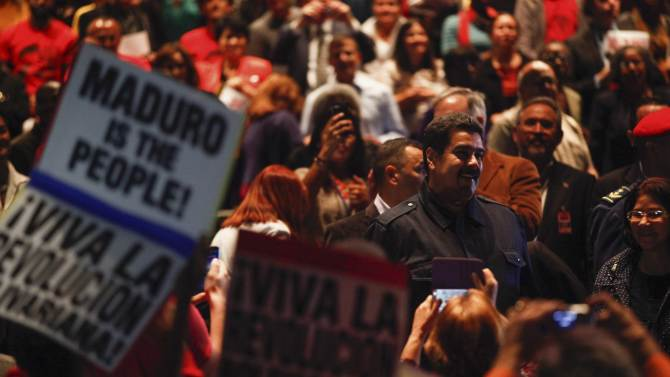 Venezuela's President Nicolas Maduro greets supporters during a meeting in New York