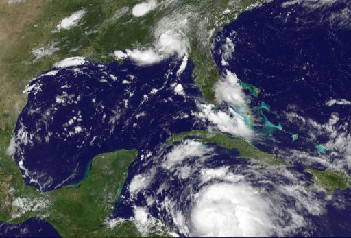 <p>This NASA satellite image shows Tropical Storm Ernesto in the Caribbean on August 6. The storm picked up strength and was expected to reach hurricane force later in the day, threatening the coasts of Belize and Mexico.</p>