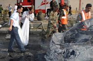 Picture released by the Syrian Arab News Agency (SANA) shows a body being removed from the site of twin blasts in Damascus, May 10. The UN Security Council condemned the deadliest bomb attacks of Syria&#39;s 14-month uprising, urging all sides to stick to an international peace plan after at least 55 people were killed