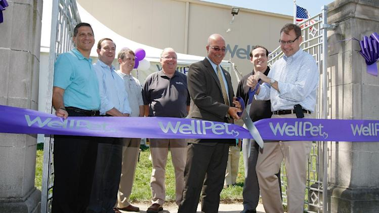 COMMERCIAL IMAGE -  WellPet CEO Tim Callahan and Mishawaka Mayor Dave Wood are joined by the WellPet team to officially open the natural pet food company's expanded facility at the WellPet Mishawaka Plant Open House Event on Wednesday, June 20, 2012 in Mishawaka, IN. (Left to Right) Thano Chaltas, Steve Harris, Greg Kean, Steve Griswold, Mayor Wood, Nick Deldon, Tim Callahan (Photo by Scott Boehm/Invision for WellPet/AP Images)