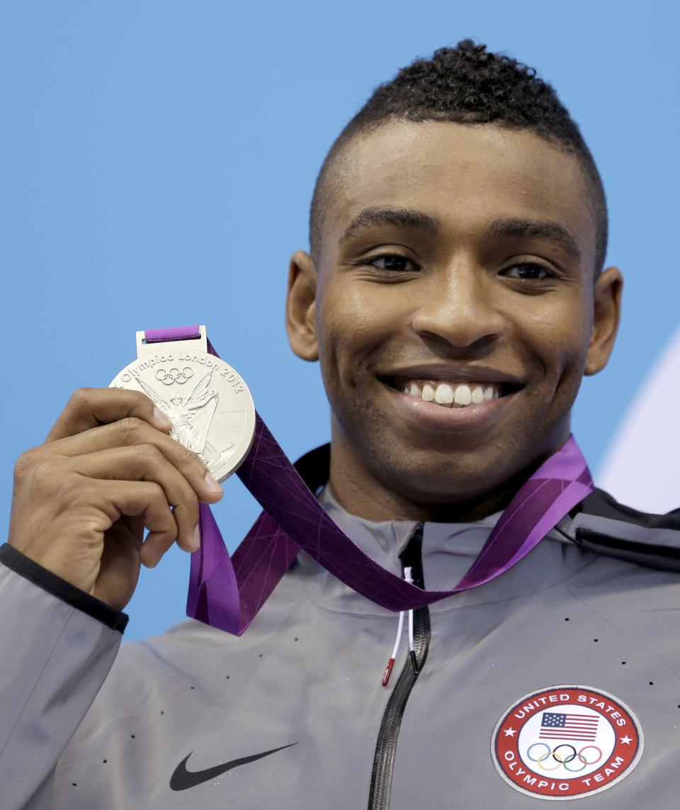 United States' Cullen Jones holds his silver medal in the men's 50-meter freestyle swimming final at the Aquatics Centre in the Olympic Park during the 2012 Summer Olympics in London, Friday, Aug. 3, 2012. (AP Photo/Michael Sohn)
