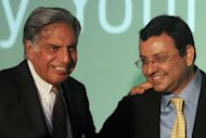 Tata chairman Ratan Tata (left) shares a joke with with deputy chairman Cyrus Mistry during a press conference in April 2012. Tata says Mistry has the capacity and ability to lead the automobile-to-software group in the years to come