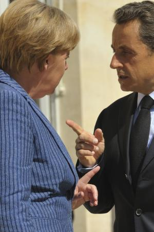 France's President Nicolas Sarkozy, right, and German Chancellor Angela Merkel gesture to each other prior to meeting at the Elysee Palace, Tuesday Aug. 16, 2011. (AP Photo/Philippe Wojazer, Pool)