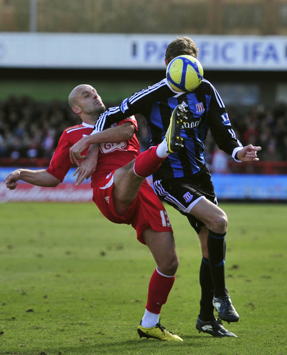 Crawley Town's English Midfielder David Hunt (L) Vies With Stoke City's English Striker Peter Crouch (R)   AFP/Getty Images
