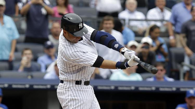 New York Yankees' Derek Jeter singles during the first inning of a baseball game against the Kansas City Royals at Yankee Stadium Thursday, July 11, 2013, in New York. (AP Photo/Seth Wenig)
