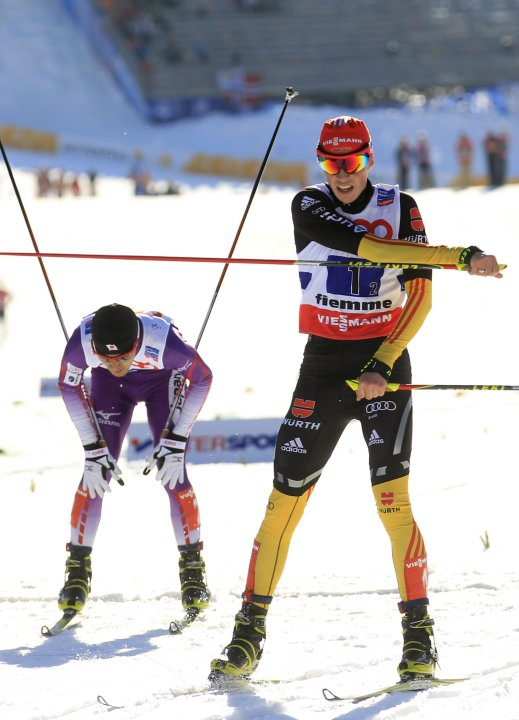 Frenzel of Germany skis past Watabe of Japan while finishing third in the Nordic Combined Team Sprint 2x7.5km competition at the Nordic Ski World Championships in the northern mountain resort of Teser