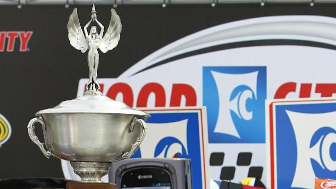 NASCAR Sprint Cup Series driver Kasey Kahne (5) stands with the championship trophy after winning the Food City 500 auto race, Sunday, March 17, 2013, in Bristol, Tenn. (AP Photo/Wade Payne)
