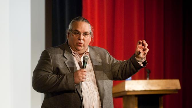 In this March 3, 2010 photo, the Rev. Carl Keyes speaks to an audience in Harrisonburg, Va., about his life experiences relating to his organization, Aid for the World. Before the Sept. 11, 2001 attacks, Keyes was a little-known pastor of a small New York City congregation searching for members and money. When the twin towers fell, his fortunes changed. Donors poured $2.5 million into the minister's charity to help 9/11 victims. More opportunities to raise relief money would come later, with at least another $2.3 million collected for efforts along the hurricane-ravaged Gulf Coast, in the poorest corners of West Virginia and Tennessee, and even in remote African villages. Tens of millions more flowed through his fingers from the sale of church properties. But Keyes, a one-time construction worker, did more than help the needy with the millions donated - he helped himself. According to financial records, internal correspondence and interviews with former employees conducted by The Associated Press, Keyes blurred the lines between his charities, his ministry and his personal finances while promoting himself as an international humanitarian. (AP Photo/Ryan Freeland)