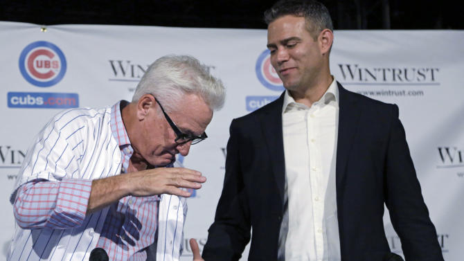FILE -  In this Nov. 3, 2014 file photo, Joe Maddon, left, shakes hands with Theo Epstien, president of baseball operations, after Maddon was introduced as the new manager of the Chicago Cubs baseball team. As the season ended the Cubs began a long-planned renovation of Wrigley Field, hired big-name manager Maddon, and added high-priced free agents. The Cub's moves are one of The Associated Press' Top 10 Illinois stories of the year. (AP Photo/M. Spencer Green, File)