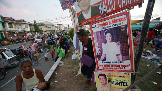 In this May 5, 2013 photo, a poster of former Philippine First Lady Imelda Marcos is on display at town center in Ilocos Norte province, northern Philippines. Twenty-seven years after her dictator husband was ousted by a public revolt, Imelda Marcos has emerged as the Philippines' ultimate political survivor: She was back on the campaign trail this week, dazzling voters with her bouffant hairstyle, oversized jewelry and big talk in a bid to keep her seat in Congress. (AP Photo/Aaron Favila)
