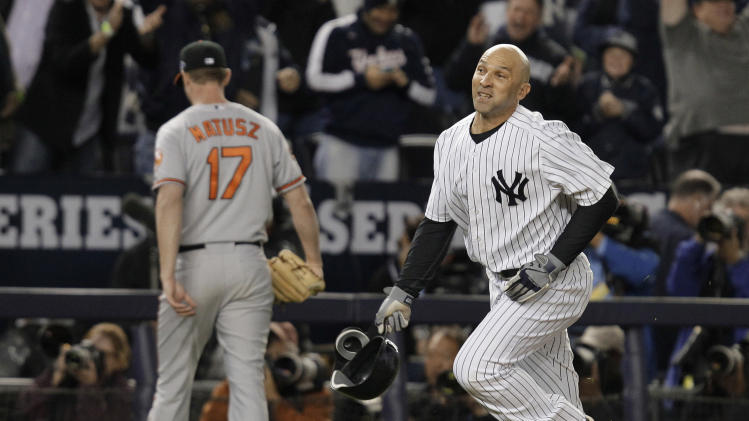 New York Yankees' Raul Ibanez (27) runs past Baltimore Orioles pitcher Brian Matusz after hitting the game-winning home run during the 12th inning of Game 3 of the American League division baseball series Wednesday, Oct. 10, 2012, in New York. The Yankees won 3-2. (AP Photo/Kathy Willens)