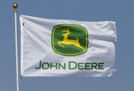 <p>               In this Aug. 31, 2011 photo, a flag displaying the John Deere logo flies at the John Deere farming equipment exhibit area during the Farm Progress Show in Decatur, Ill. Deere & Co., the world's largest maker of agricultural equipment, reported a bigger fourth-quarter profit Wednesday, Nov. 21, 2012, as it sold more equipment at higher prices, but results still missed analyst expectations. (AP Photo/Seth Perlman)