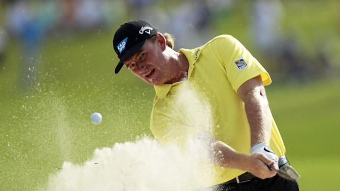 Ernie Els hits out of a bunker onto the 18th green during the first round of a sudden-death playoff against Jason Dufner during the final round of the Zurich Classic golf tournament at TPC Louisiana in Avondale, La., Sunday, April 29, 2012. (AP Photo/Gerald Herbert)