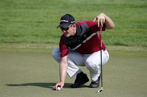 Rose of England replaces the ball on the 10th green during the second round of the DP World Tour Championship in Dubai