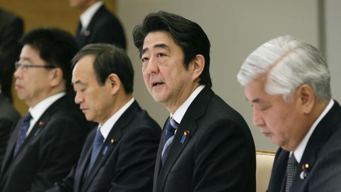 Japan's PM Abe talks during a ministerial meeting about a video, from Islamic State militants that purportedly showed the beheaded body of Japanese journalist Goto, at the prime minister's official residence in Tokyo
