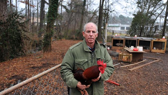 """In this Jan. 18, 2011 photo, Andrew Wordes poses for a photo at his home in Roswell, Ga. An explosion on Monday, March 26, 2012, rocked the suburban Atlanta home of a man known for his fight to keep chickens on his property, and emergency officials say a body was found inside. Marshals had been on the scene for about two hours trying to evict Andrew Wordes, who's known as the """"Chicken Man,"""" when the explosion happened around 12:45 p.m., said Antonio Johnson of the Fulton County marshal's office. (AP Photo/Atlanta Journal-Constitution, Brant Sanderlin)"""