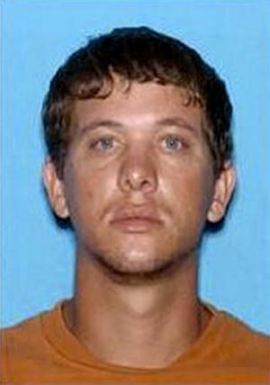 """In this undated FBI photo, Dylan Dougherty Stanley, 26, is shown.  Police said Tuesday they have received """"credible information"""" that people matching the description of three siblings connected to crimes in Florida and Georgia were spotted in Colorado.  Authorities have been pursuing Ryan Edward Dougherty, Dylan Dougherty Stanley and Lee Grace Dougherty since Tuesday, Aug. 2, 2011. (AP Photo/FBI via the Atlanta Journal & Constitution)"""