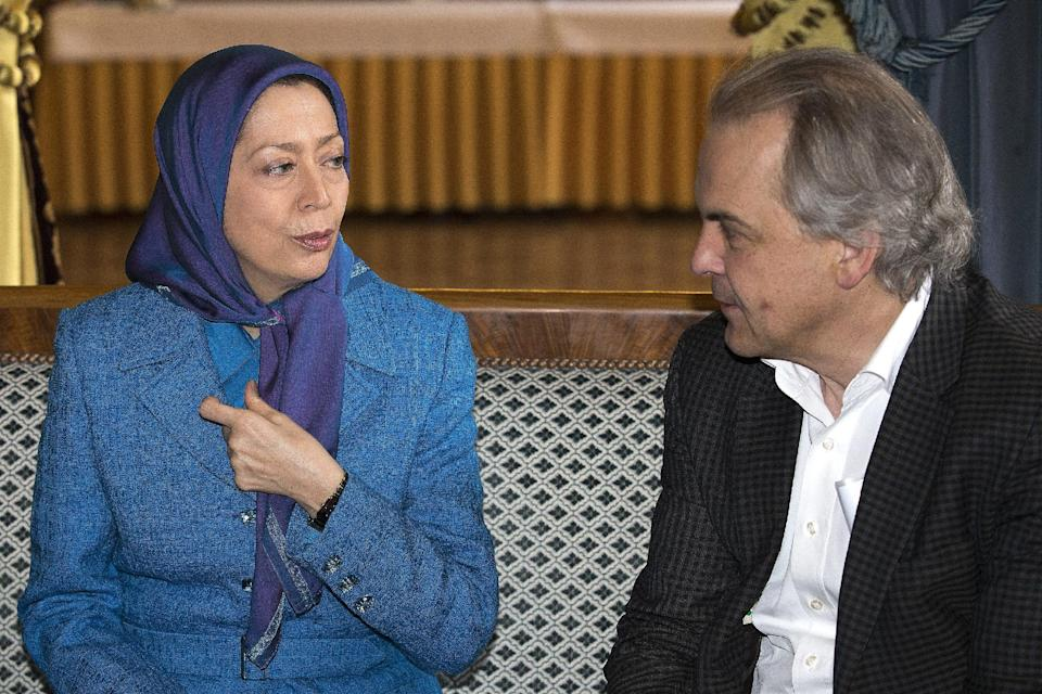 Maryam Rajavi, left, President of the National Council of Resistance of Iran, left, speaks with Remy Pagani, right, Mayor of Geneva, during al meeting at the Palais Eynard, in Geneva, Switzerland, Wednesday, Feb. 27, 2013. (AP Photo/Keystone, /Salvatore Di Nolfi)
