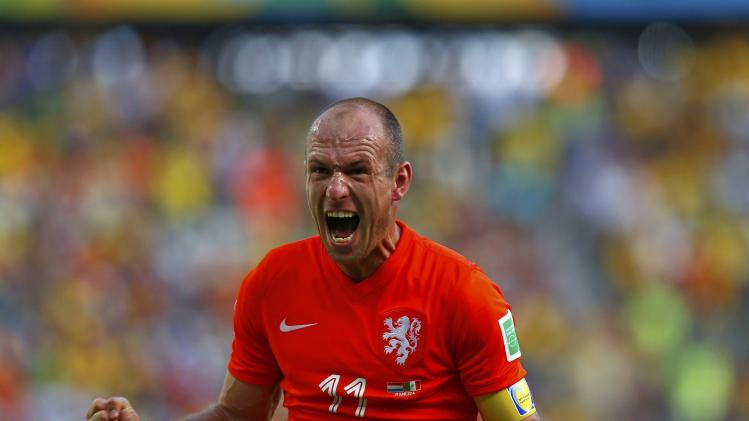 File photo of Arjen Robben of the Netherlands celebrating after winning their 2014 World Cup round of 16 game against Mexico at the Castelao arena in Fortaleza