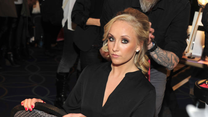 Nastia Liukin attends the Red Dress Collection 2013 Fashion Show, on Wednesday, Feb. 6, 2013 in New York. (Photo by Charles Sykes/Invision/AP)