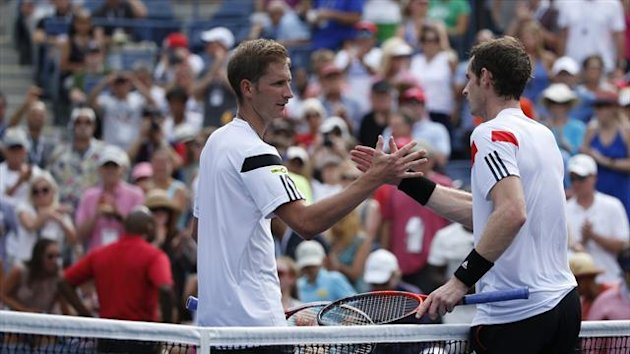 Florian Mayer of Germany (L) congratulates Andy Murray of Britain after Murray won their match at the U.S. Open tennis championships in New York September 1, 2013 (Reuters)