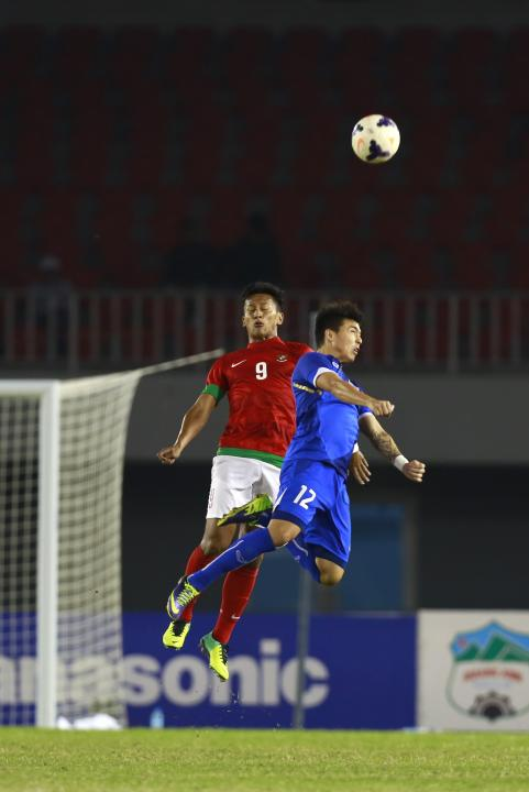 Chappuis of Thailand challenges Munawar of Indonesia during their men's final soccer match at 27th SEA Games in Naypyitaw