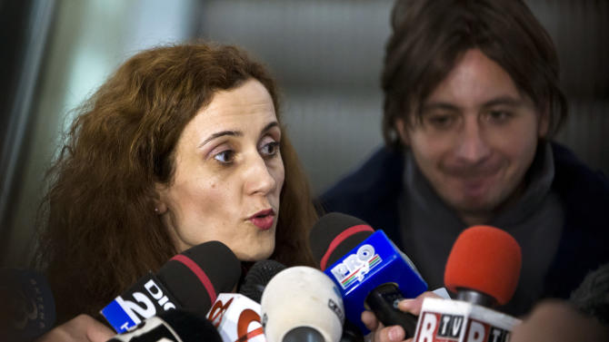 Daniela Dede, left, lawyer for Mihai Alexandru Bitu, not seen, speaks to media in Bucharest, Romania, Friday, Jan. 25, 2013. Lawyers for three Romanians Mihai Alexandru Bitu, Radu Dogaru and Eugen Darie, charged  with stealing valuable paintings from a museum in the Netherlands last year, including works by Picasso, Monet and Matisse say there is insufficient evidence to charge them. (AP Photo/Vadim Ghirda)