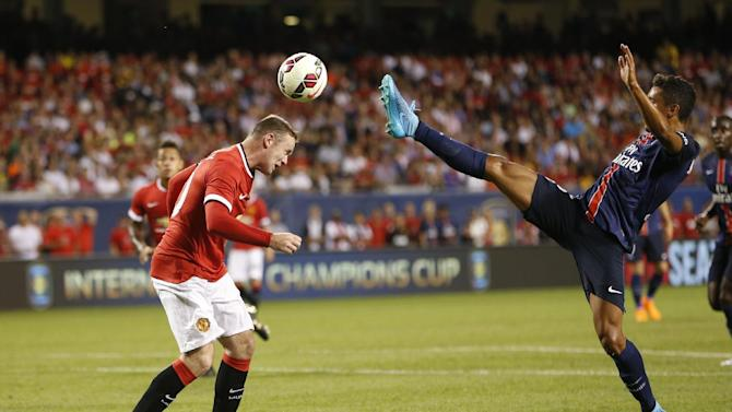 Manchester United's Wayne Rooney, left, headers the ball in front of Paris Saint-Germain's Marquinhos  during a soccer match at Solider Field as Manchester United played Paris Saint-Germain during International Champions Cup play in Chicago Wednesday, July 29, 2015. (AJ Mast / AP Images for International Champions Cup)