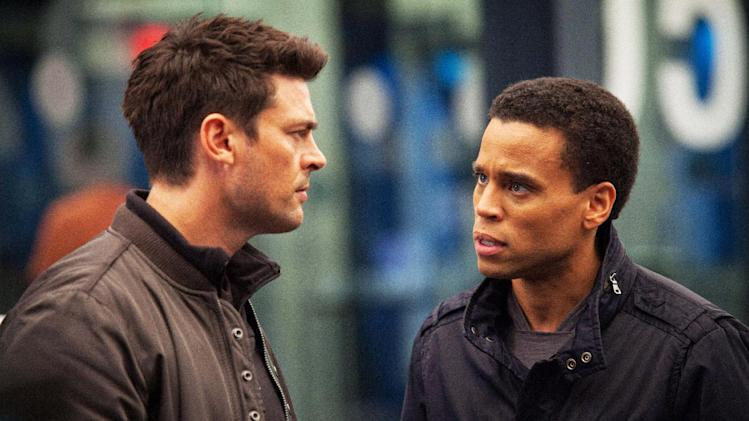 "In this undated publicity photo released by FOX, Karl Urban, left, as John Kennex and Michael Ealy as Dorian partner to fight crime in the year 2048 in the new FOX drama, ""Almost Human,"" premiering this fall on FOX.  (AP Photo/FOX, Liane Hentscher)"