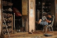 <p>A machinist sits outside his workshop in Shanghai. Weak economic data in the current third quarter have raised fears China's growth may have slowed for a seventh straight quarter when GDP figures are released next month.</p>