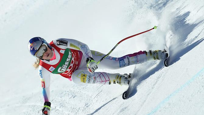 Lindsey Vonn of the United States competes on her way to take the sixth place of an alpine ski, women's World Cup downhill in St. Anton, Austria, Saturday, Jan.12, 2013. (AP Photo/Marco Trovati)