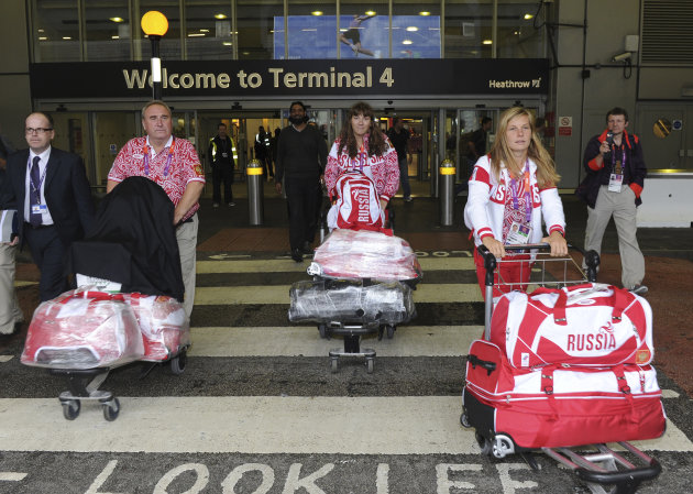 Tatiana Bazyuk and Svetlana Shnitko and another member of the Russian Olympic sailing squad (L) arrive at Heathrow airport, London