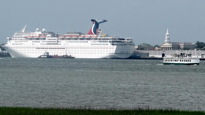 This April 18, 2012, photo taken from the Mount Pleasant, S.C. side of the Cooper River shows the Carnival Fantasy at a dock in Charleston. For more than two years the debate over cruise ships calling year-round in Charleston has raged with a state Supreme Court case, conflicting economic studies and rhetoric. Preservationists cite the threat to the city's historic character while cruise supporters say the industry is being administered appropriately and provides needed jobs and a boost to the local economy. (AP Photo/Bruce Smith)