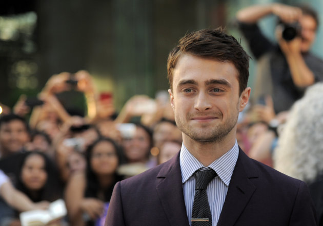 "Daniel Radcliffe, a cast member in ""Kill Your Darlings,"" poses at the premiere of the film on day 6 of the 2013 Toronto International Film Festival at Roy Thomson Hall on Tuesday, Sept. 10, 2013 in Toronto. (Photo by Chris Pizzello/Invision/AP)"