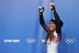 Noelle Pikus-Pace of the U.S. celebrates after winning second place in the women's skeleton event at the 2014 Sochi Winter Olympics
