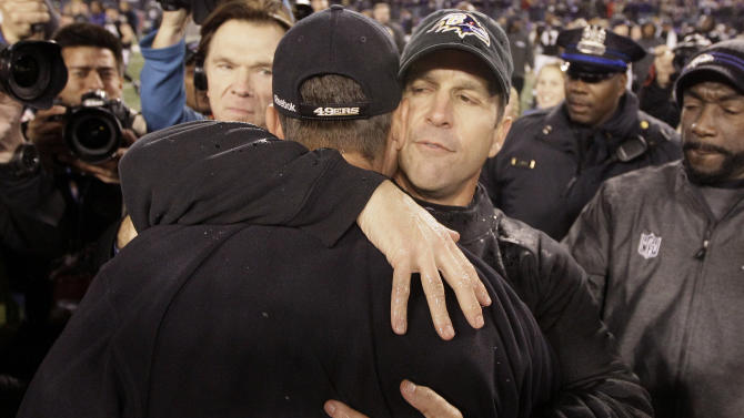 Baltimore Ravens head coach John Harbaugh,foreground, hugs his brother, San Francisco 49ers head coach Jim Harbaugh, after their NFL football game in Baltimore on Thursday, Nov. 24, 2011. Baltimore won 16-6. (AP Photo/Patrick Semansky)