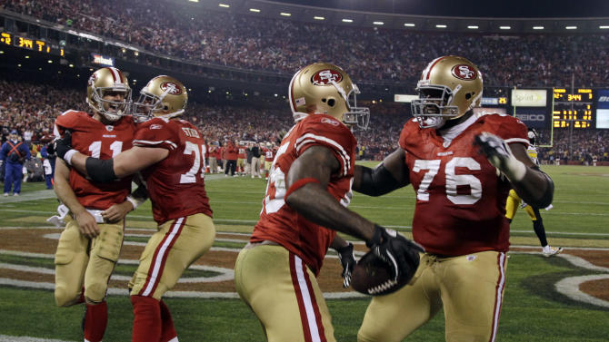 San Francisco 49ers tight end Vernon Davis (85) celebrates his touchdown with teammate Anthony Davis, right, as quarterback Alex Smith (11) is congratulated by Joe Staley in the third quarter of an NFL football game against the Pittsburgh Steelers in San Francisco, Monday, Dec. 19, 2011. (AP Photo/Paul Sakuma)